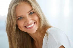 woman blonde hair perfect smile